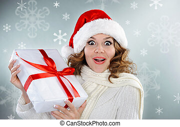 Beautiful young woman with Christmas present box