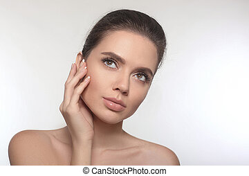 Beautiful young woman with clean fresh skin care. Beauty face portrait of attractive pretty girl. Facial treatment. French Manicured nails.