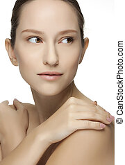 Beautiful young woman with clean skin of the face.