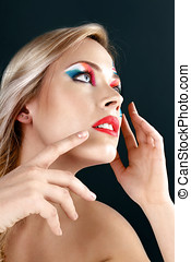 Beautiful young woman with creative make-up