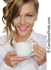 Beautiful young woman with cup in her hand