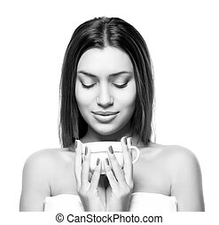 beautiful young woman with cup of coffee, on white background