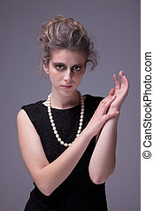 beautiful young woman with elegant black dress, studio shot
