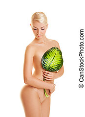 Beautiful young woman with exotic green leaf. Isolated on white