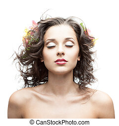 beautiful young woman with flower in blowing hair