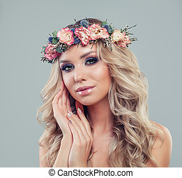 Beautiful Young Woman with Flowers Haircut. Spring Beauty