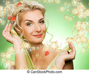 Beautiful young woman with fresh flowers in her hair. Spring