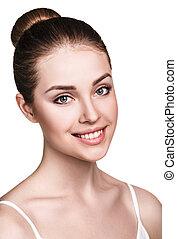 Beautiful young woman with fresh skin.