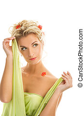Beautiful young woman with fresh spring flowers in her hair.