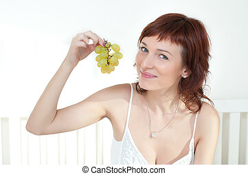 Beautiful young woman with fruit