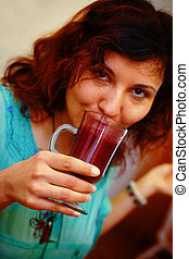 Beautiful Young Woman with Fruit smoothie