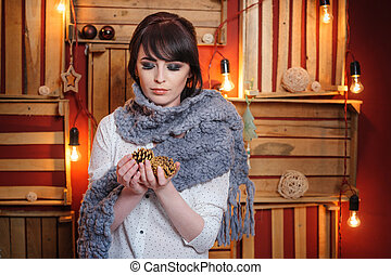 beautiful young woman with grey knitted scarf in the Studio