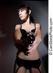 Beautiful young woman with gun