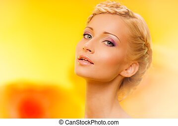 Beautiful young woman with hairdo portrait