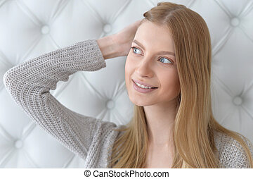 beautiful young woman with hand in hair