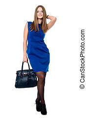 Beautiful young woman with handbag