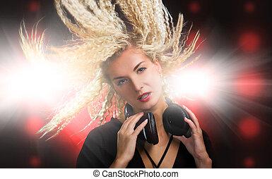 Beautiful young woman with headphones in nightclub