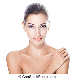 beautiful young woman with healthy face and clean skin...