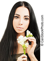 Beautiful young woman with  healthy skin and hair