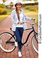young woman with her bike at the park