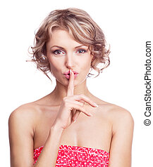 a sign of being quiet- hush - beautiful young woman with her...