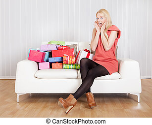 Beautiful young woman with her presents