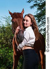 beautiful young woman with horseback
