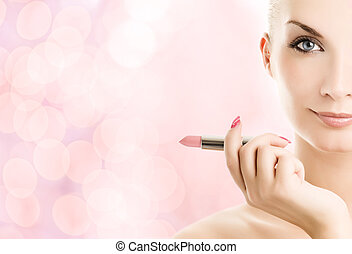Beautiful young woman with lipstick over abstract pink background