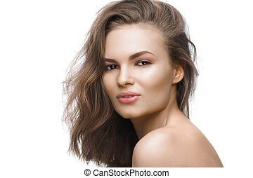 Beautiful young woman with long brown hair on white background.
