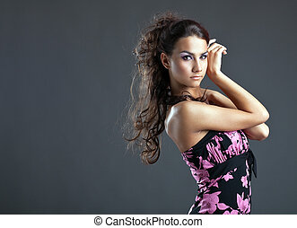 Beautiful young woman with long hair portrait