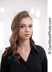 Beautiful young woman with make-up in a black shirt