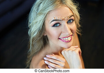 beautiful young woman with make-up in studio