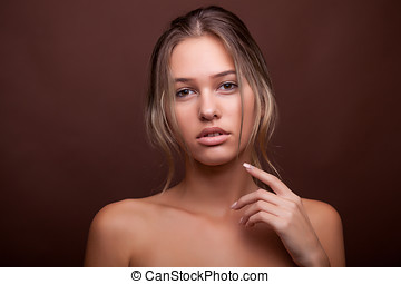 Beautiful young woman with no make up and perfect skin