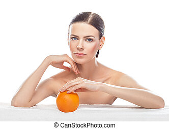 beautiful young woman with orange isolated on white background