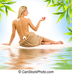 Beautiful young woman with orchid flowers reflected in rendered water