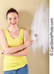 beautiful young woman with paintbrush