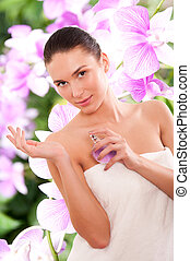 Beautiful young woman with parfume