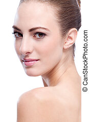 beautiful young woman with perfect skin and soft makeup -...