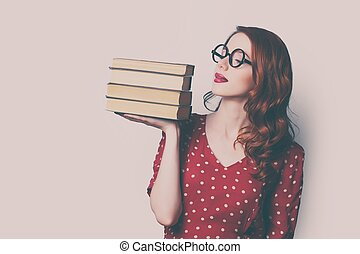 woman with pile of books