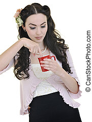 beautiful young woman with red cup of coffee isolated on white