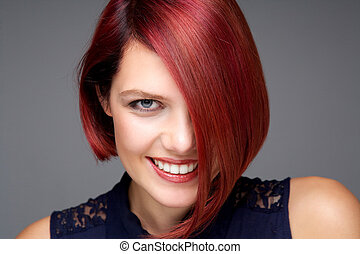 Beautiful young woman with red hair smiling
