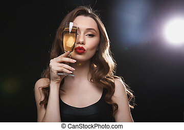 Beautiful young woman with red lips and glass of champagne