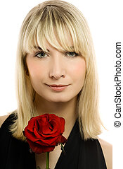 Beautiful young woman with red rose. Isolated on white