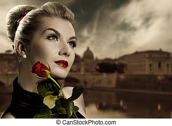 Beautiful young woman with red rose. Retro potrait