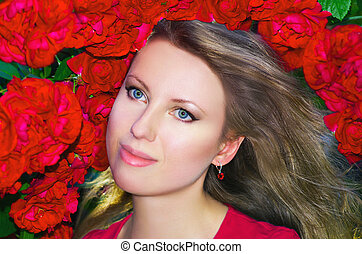 beautiful young woman with red roses