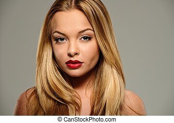 Beautiful young woman with seductive red lips