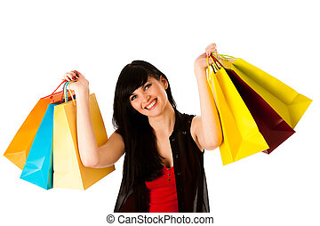Beautiful young woman with shopping bags isolated