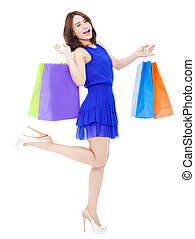 beautiful young woman with shopping bags. isolated on white