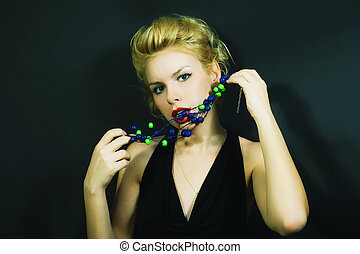 beautiful young woman with stylish hair and beads