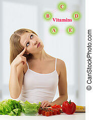 beautiful young woman with vegetables choose healthy foods rich in vitamins